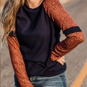 Boutique navy and animal print top